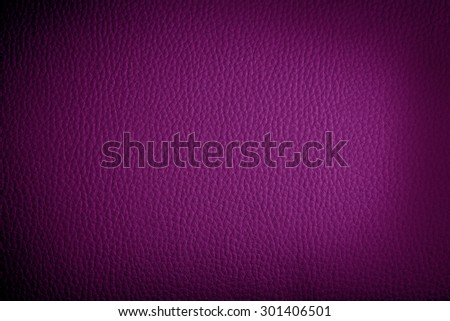 fuchsia leather background or texture with dark vignette borders