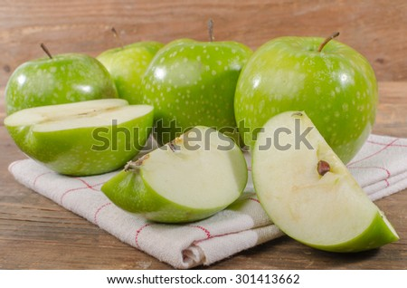 Fresh green apples on wooden background #301413662