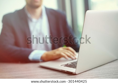 Young man working with laptop, man's hands on notebook computer, business person at workplace #301440425