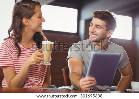 Smiling friends looking at each other at coffee shop #301695608