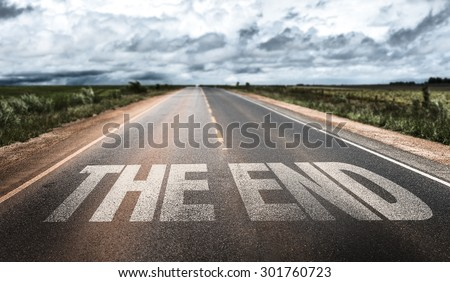 The End written on rural road Royalty-Free Stock Photo #301760723