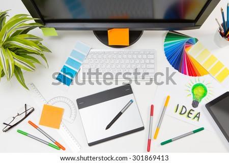 Graphic designer at work. Color swatch samples. #301869413