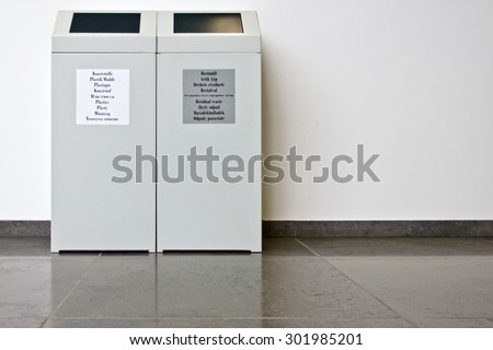 Trash bins to separate waste in a public building, copy-space  #301985201