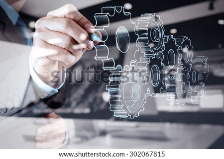 double exposure of businessman hand draws gear to success concept Royalty-Free Stock Photo #302067815