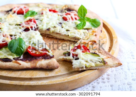 Green vegetarian pizza with olive paste and goat cheese #302091794