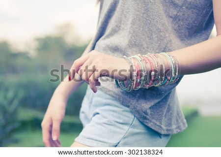 female with bracelets #302138324