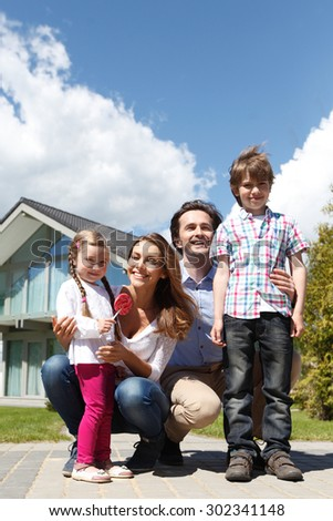 happy family standing in front of the house #302341148