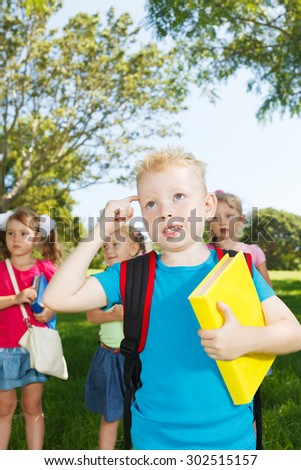 Preschoolers with books thinking at park #302515157