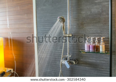 Shower while running water #302584340