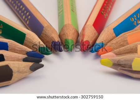 Set of crayons pointing to the center on white background #302759150