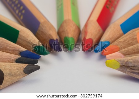 Set of crayons pointing to the center on white background #302759174