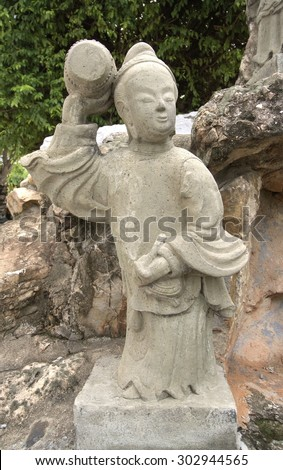 BANGKOK, THAILAND - August 1 :stone statue chinese style at Wat Pho Bangkok, Thailand on August 1, 2015 #302944565