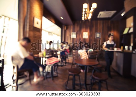 Coffee shop - cafe  blurred background with bokeh image Royalty-Free Stock Photo #303023303