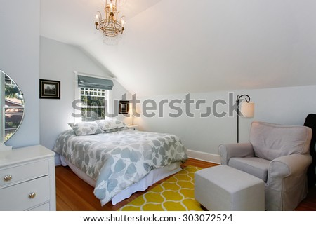 Bright bedroom with hardwood floor, and pastel spring colors. #303072524