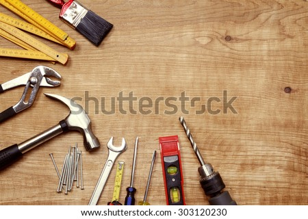 Assorted work tools on wood #303120230
