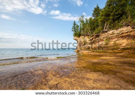 Lake Superior shoreline - Rocky outcroppings define the shoreline of Pictured Rocks National Lakeshore near Au Train Michigan.