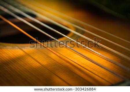 Guitar strings Royalty-Free Stock Photo #303426884
