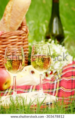 Picnic basket with apples bread cheese and wine #303678812