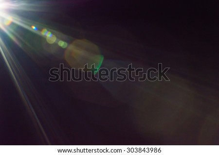 lens flare light Royalty-Free Stock Photo #303843986