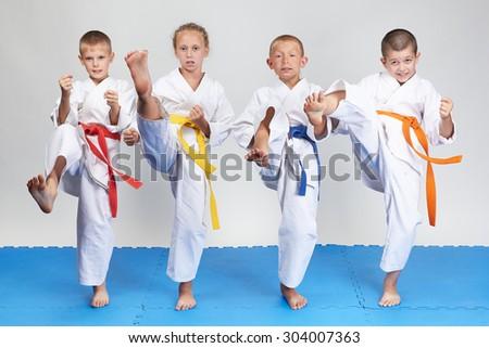 The blow mae-geri are beating sportsmens in karategi #304007363
