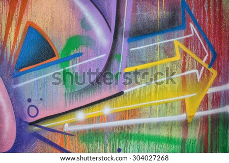 close-up detail of graffiti painting - arrows pointing sideway #304027268