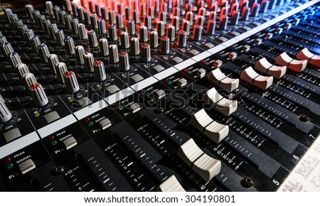 detail sound mixer in red, white and blue light with great perspective, the version with great detail controls