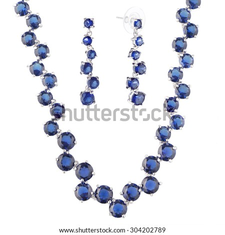 silver metal necklace and earrings  with blue crystal, isolated on white background #304202789