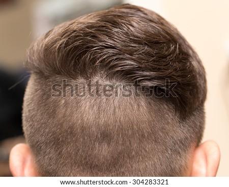 Men's haircut at the beauty salon #304283321