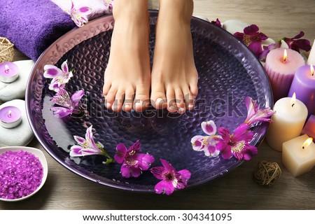 Female feet at spa pedicure procedure Royalty-Free Stock Photo #304341095