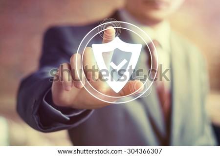 Businessman hand press shield security virus web button icon