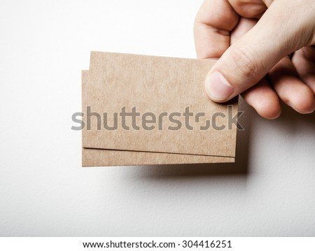 Mockup of two craft business cards and mans hand.
