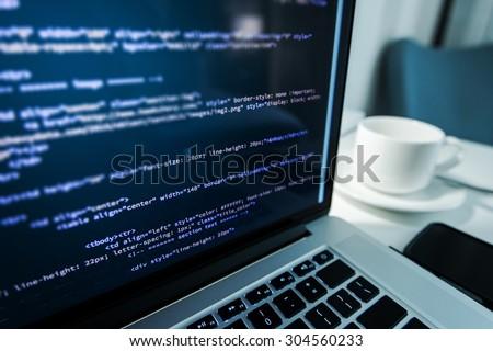 Website Coding. Website HTML Code on the Laptop Display Closeup Photo. Webdesigner Workstation.
