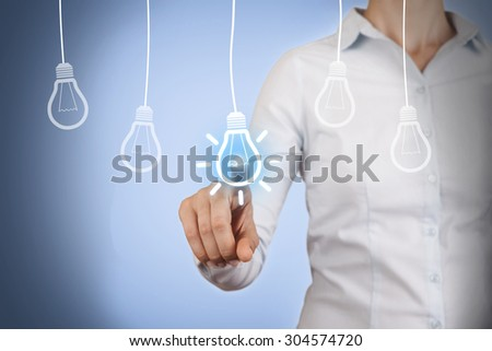 Idea Light Bulb Concept Touching on Visual Screen  #304574720