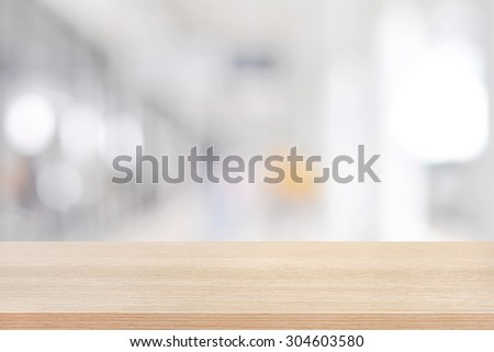 Wood table top on blurred white gray background of building hallway #304603580