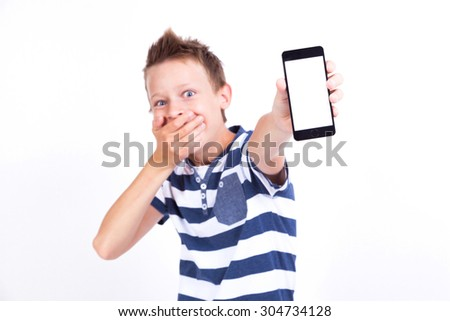 smiling student with a tablet in his hand screen to the client on a white background shows the application photo with depth of field. picture with artistic blur