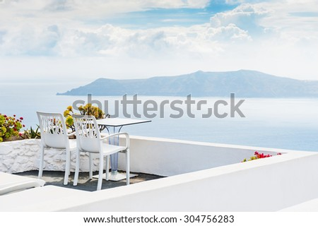 Beautiful terrace with sea view. White architecture on Santorini island, Greece.  #304756283