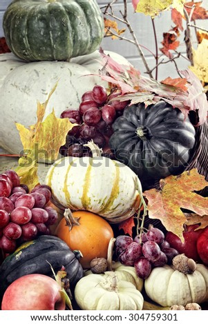 Cornucopia or Horn of Plenty with lots of fresh vegetables and fruit spilling out.