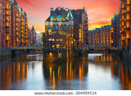Old Speicherstadt in Hamburg illuminated at night. Sunset background #304909514