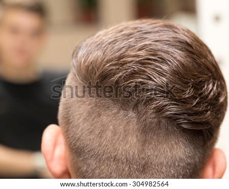 Men's haircut at the beauty salon #304982564