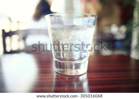 glass of water on a table in a restaurant #305016068