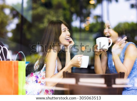 two young woman chatting in a coffee shop #305063513