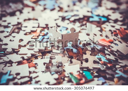 pieces of a puzzle Royalty-Free Stock Photo #305076497