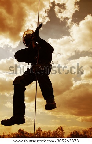 Special forces operator during assault rappeling with weapons #305263373