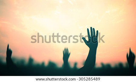 International migrants day concept: Silhouette many people raised hands over autumn sunset background #305285489