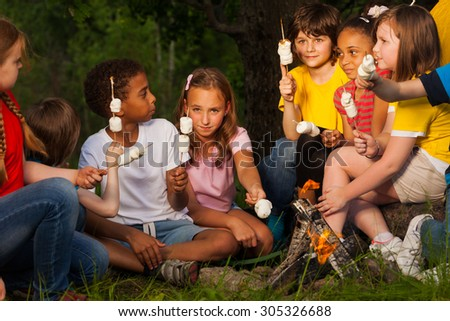 Group of children with s'mores near bonfire #305326688