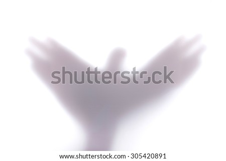 Silhouette creating a shape of a flying bird with hands, behind a diffuse surface. Shadow Hands Bird Shape. Shadow Hands Bird on White Background . Shadow Hands Bird ISOLATED. #305420891