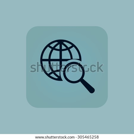 Image of globe under loupe in square, on pale blue background