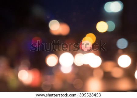 blured bokeh from light in city at midnight time,vintage effect. #305528453