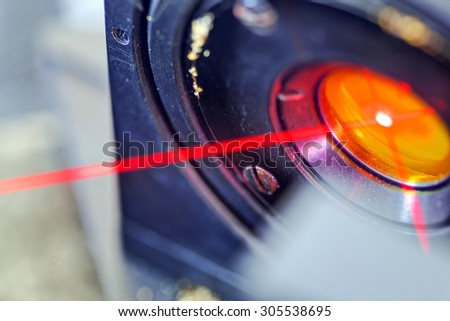 Red laser on optical table in physics laboratory #305538695