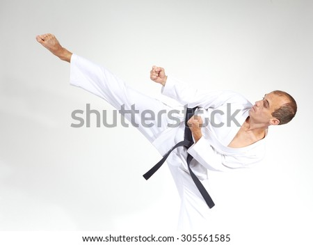 Mawashi geri beats the sportsman with black belt #305561585